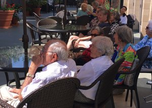 A picture of Chateau La Jolla Residents Enjoying Happy Hour on the Patio.