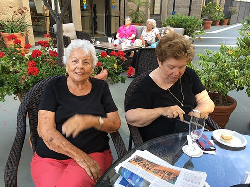 A picture of Chateau La Jolla residents enjoying Social Happy Hour w/Danny Gali.
