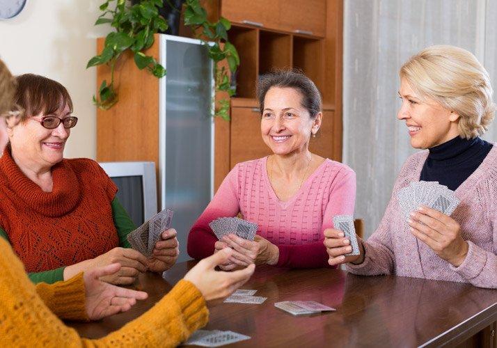 A group of senior women playing Bridge